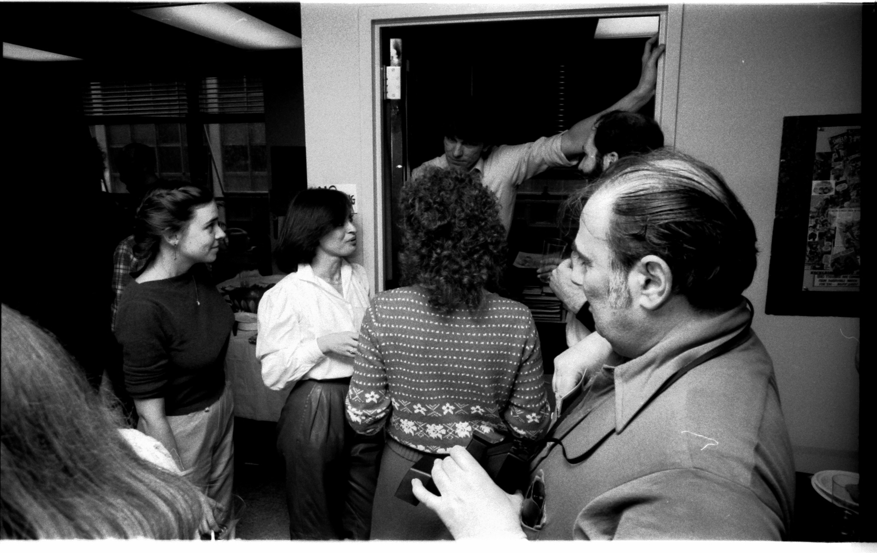 Talkin' to the Big Guy-- Jim Shooter in the doorway. L-R: Deb Highly, Carol Jazwinski and the back of Nancy Golden. Not sure who is obscured by Danny Crespi in the foreground-- could be Allan Weiss?