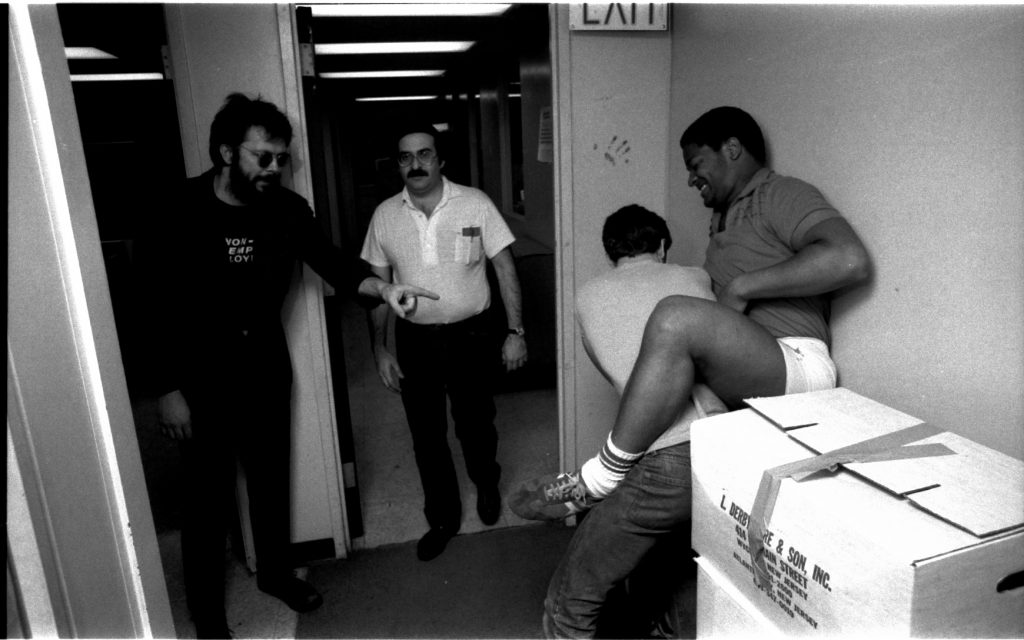 Rick Parker warns of dire consequences. Barry Shapiro blithely walks through the shot. Lance seems to be getting the upper, uh, leg on Jack!