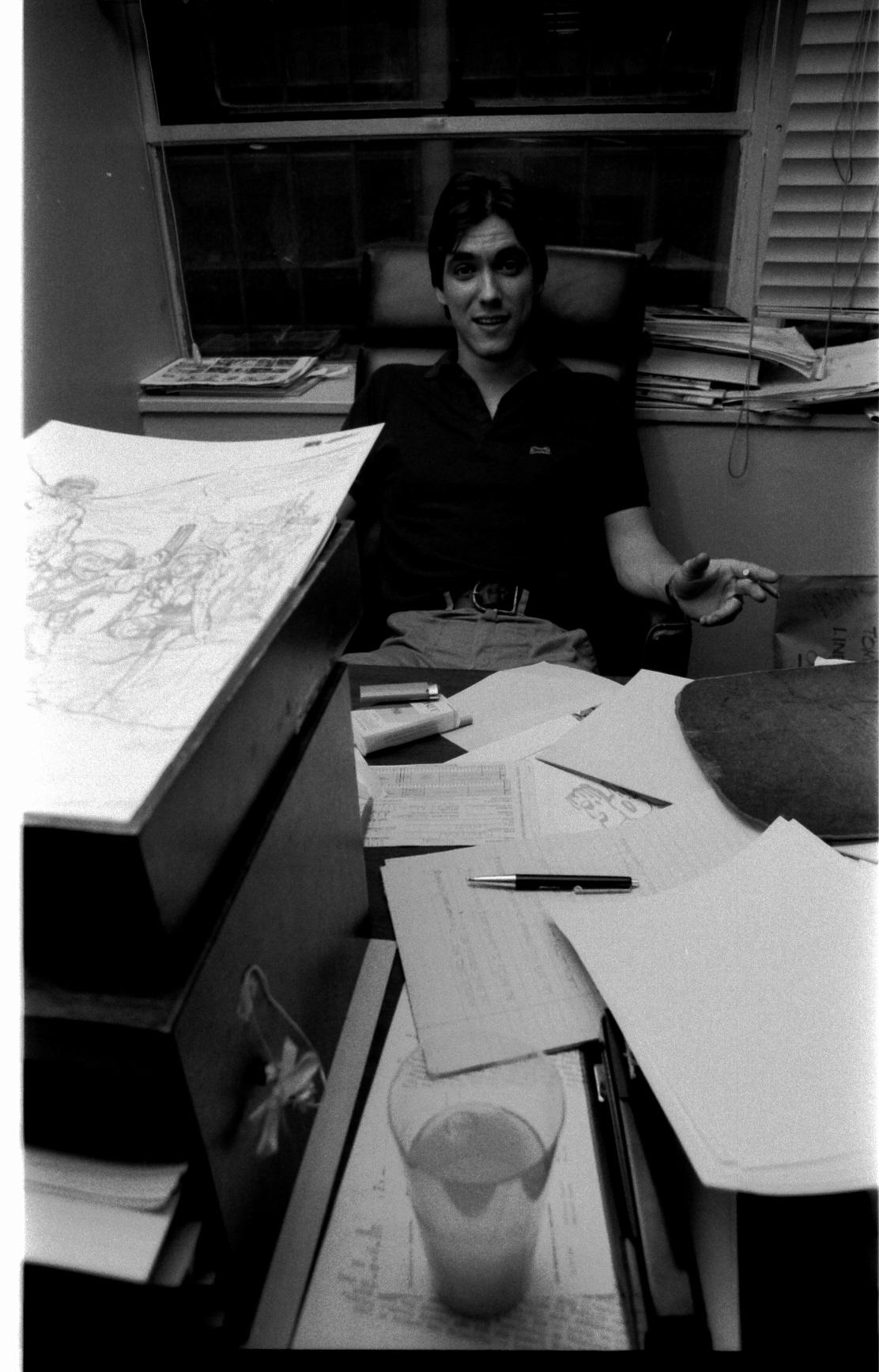 Bob Layton tirelessly fills out art vouchers.