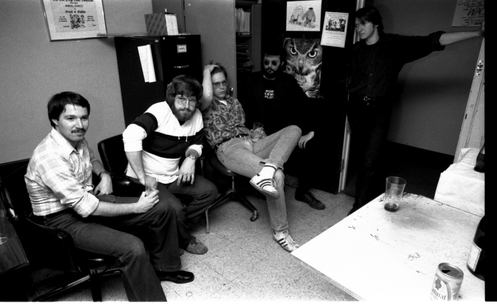 Joe Albelo, Ron Zalme, Mike Carlin, Rick Parker sitting. Bob Camp (who was serving as on-staff art-repair guy, while John Tartag was off penciling the book about the Pope!) blocks the door. They're all waiting either for more food or the Wack Offs to start.