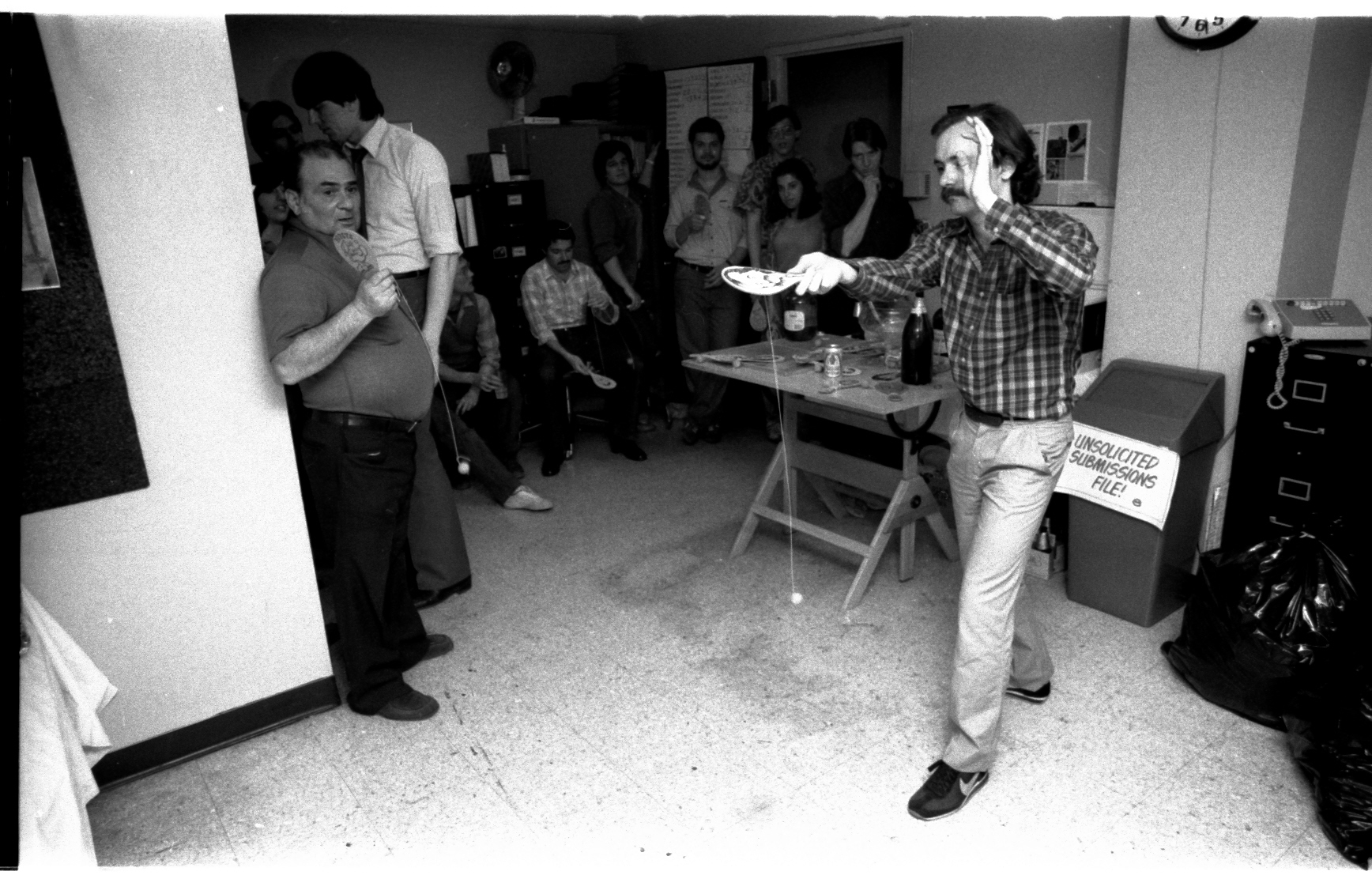 Mark Gruenwald, who really did practice, shows us how it's done! Danny can't believe his eyes. A dejected Shooter just leaves the room (to go to his office-- this whole area is his ante-room).
