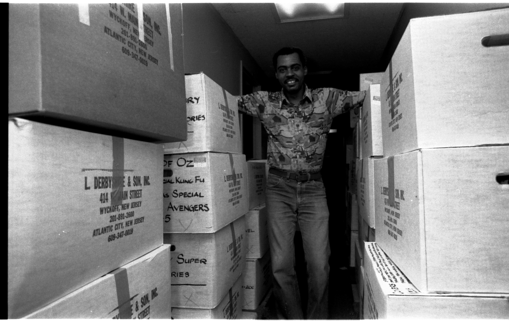 "Hard to believe, but the Wack-Off Games were the last Hurrah! of the 57th St. offices of Marvel. Held on a Friday, that weekend was Moving Day down to 387 Park Ave South! Here is Mailroom Specialist, Cliff, who was responsible for ""stripping film flats"" and storing them, surrounded by boxes filled with film."