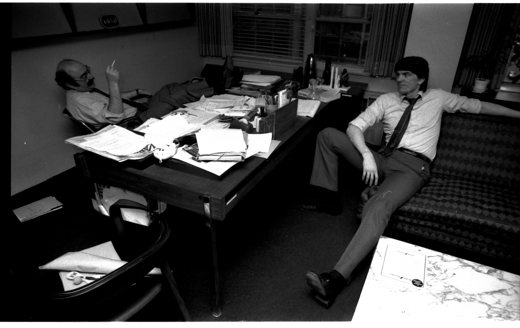 The calm after the storm. A peaceful moment between Mike Hobson and Jim Shooter in Mike's spacious corner office. That damned couch has been at Marvel since I was a downy-cheeked messenger boy-- turning up in Stan's offices like a bad penny, year in, year out. Mike must've lost a bet to have gotten that couch. I'm pretty sure it did not survive the trip downtown...