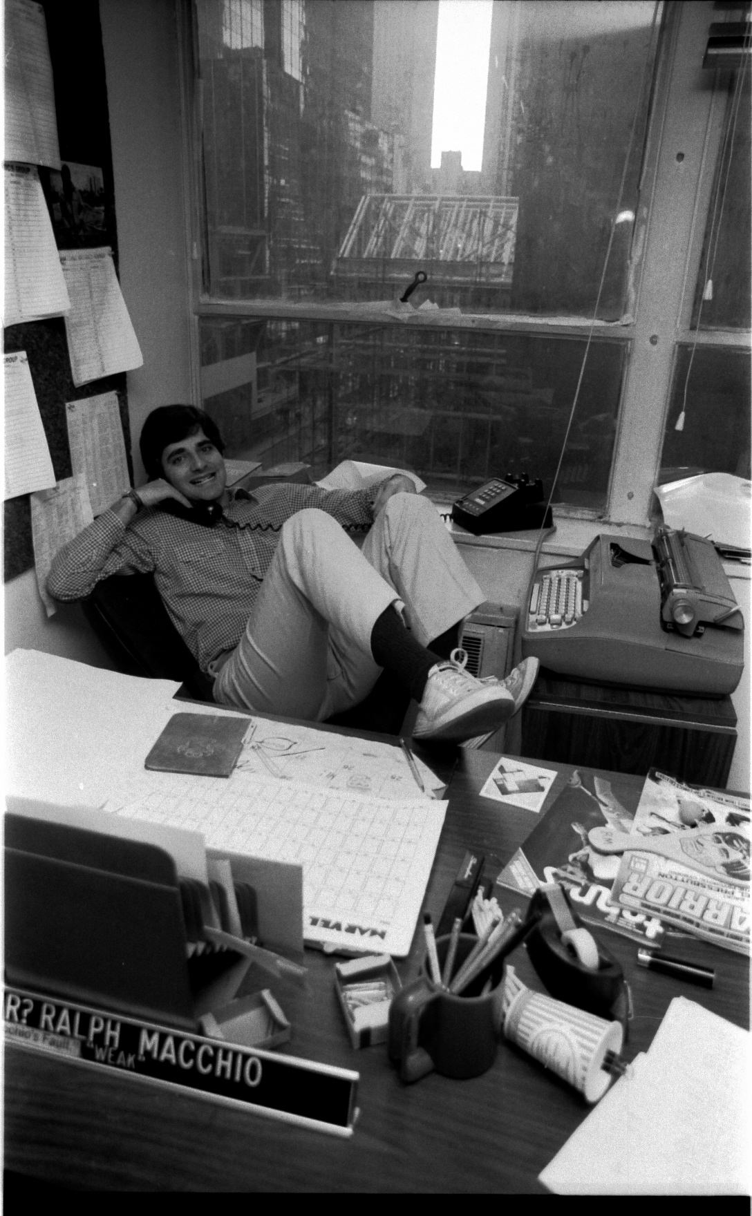 Ralph Macchio in a very typical pose. Ralph has an original Selectric typewriter in front of him, that never left him! Ralph refuses-- to this day-- to step up to any writing device more modern.