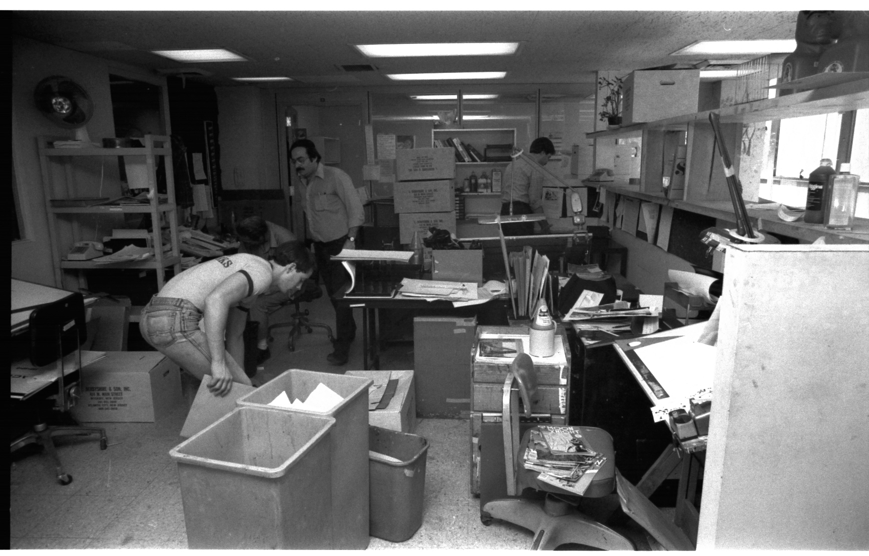 """The Marvel Bullpen, minutes before the trucks were to take off! We knew how to work right up to the last possible second! Jack Morelli scrapes up an old """"US 1"""" page from the floor, Barry Shapiro wipes his feet on a """"Werewolf By Night"""" and Joe Albelo makes a quick correction to a current """"X-Men"""" while standing up. Okay, maybe not, but we really did have to hustle."""