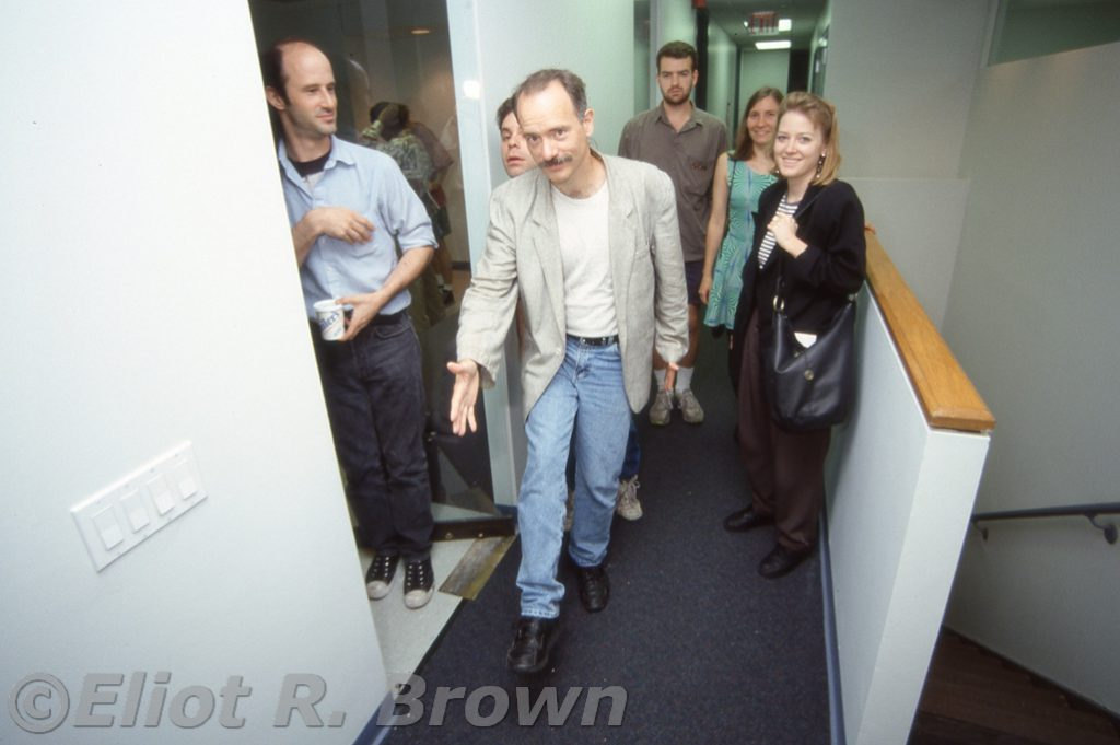 "One of my favorite natural shots of the office. Mark Gru leading the lunch pack to the elevators. Steve Alexandrov, Production Bullpenner holds the door, behind Gru's head, Dave Wohl invents ""Photo Bombing"" years before anyone knows its potential, Assistant Rob Tokar, Editrix Marie Javins and Assistant Editrix Paula Foye round out the Lunch Counter Encounter!"